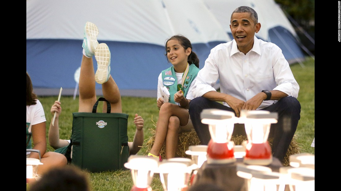 "A girl near U.S. President Barack Obama loses her balance in her chair as she and other Girl Scouts camped on the South Lawn of the White House on Tuesday, June 30. <a href=""http://www.cnn.com/2015/06/05/politics/gallery/president-obama-kids/index.html"" target=""_blank"">See more photos of Obama with children</a>"