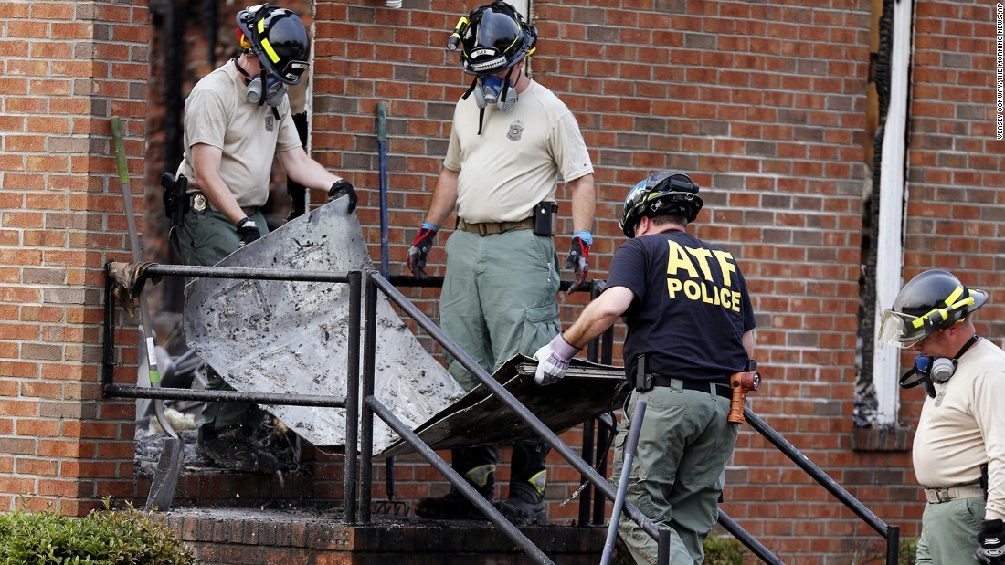 "Investigators in Greeleyville, South Carolina. remove the remains of a door from the Mount Zion African Methodist Episcopal Church on Wednesday, July 1. Federal investigators <a href=""http://www.cnn.com/2015/06/30/us/south-carolina-church-fire-mount-zion-ame/index.html"" target=""_blank"">suspect lightning might have caused the fire,</a> which drew attention because at least five other black church fires have occurred since <a href=""http://www.cnn.com/2015/06/24/us/charleston-church-shooting-main/"" target=""_blank"">the racist killings of nine people</a> in a Charleston, South Carolina, church, last month."