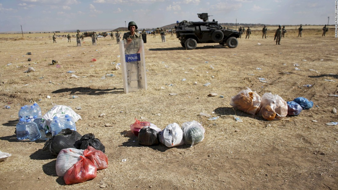 "Plastic bags were brought to the Turkey-Syria border by Turkish Kurds wanting to deliver food to their relatives in nearby Kobani, Syria, on Friday, June 26. ISIS militants <a href=""http://www.cnn.com/2015/06/26/middleeast/isis-syria/index.html"" target=""_blank"">have been targeting civilians in Kobani</a> over the past year."