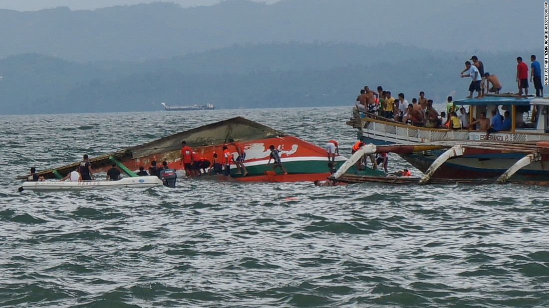 "Rescuers help passengers from a capsized ferry in Ormoc City, Philippines, on Thursday, July 2. <a href=""http://www.cnn.com/2015/07/02/asia/philippines-ormoc-ferry-capsize/"" target=""_blank"">The ferry capsized</a> Thursday as it left a port in choppy waters, leaving dozens dead and many others missing, coast guard officials said."