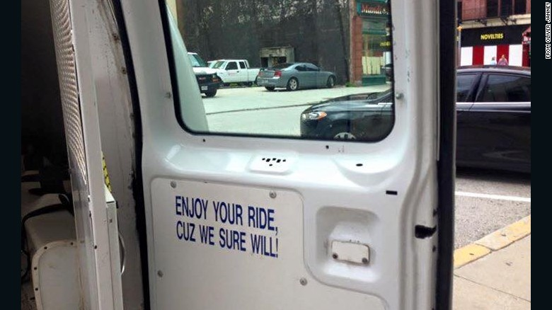 "Baltimore police van sign: ""Enjoy your ride"""
