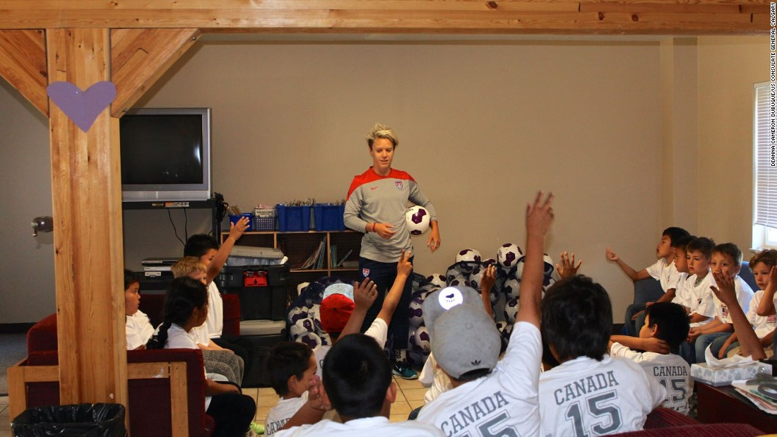 Lori Lindsey, former U.S. national footballer, speaks to young players at Chief Jimmy Bruneau Regional High School in Behchoko, Northwest Territories.