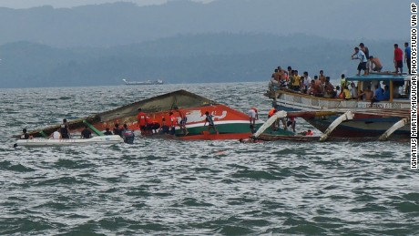 Rescuers help passengers from a capsized ferry boat in Ormoc city on Leyte Island, Philippines, on July 2, 2015.