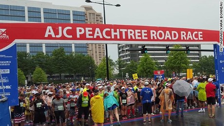 Bad weather did not put a damper on the world's biggest 10K, which kicked off Saturday in Atlanta despite rain delays.
