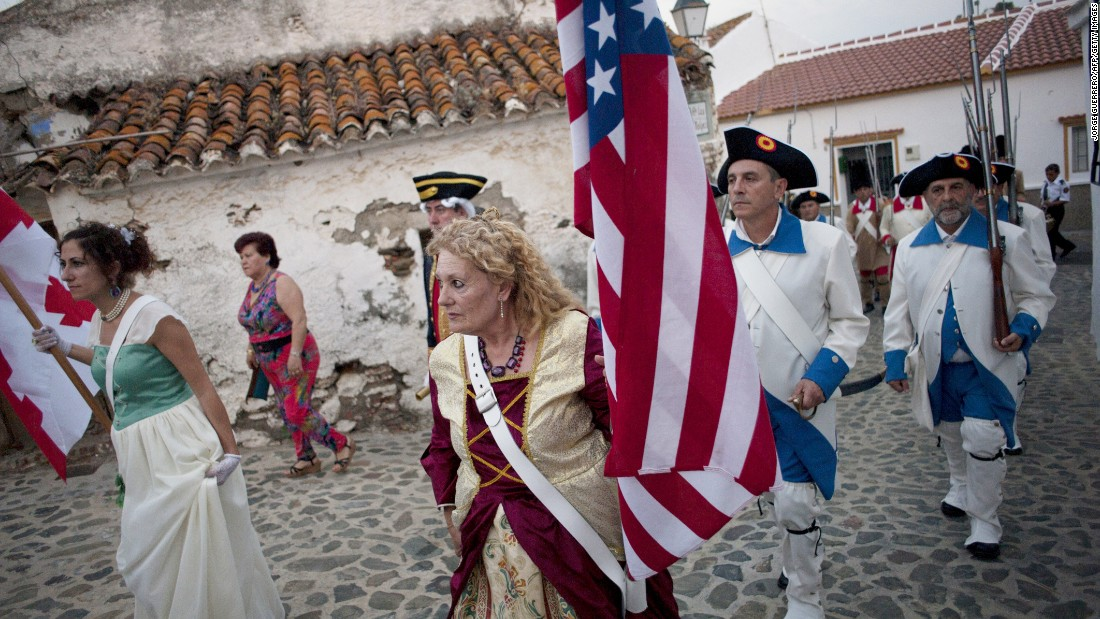Actors re-enact a battle of the American Revolution in Macharaviaya, Andalusia, Spain, on Saturday.
