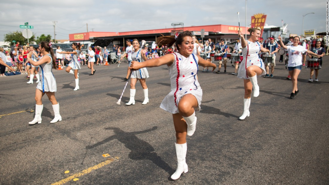 Baton twirlers march down North Grand Avenue during the 66th annual Jaycees Independence Day parade in Odessa, Texas.
