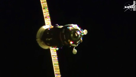 The Russian Progress 60 cargo craft is seen approaching the International Space Station.