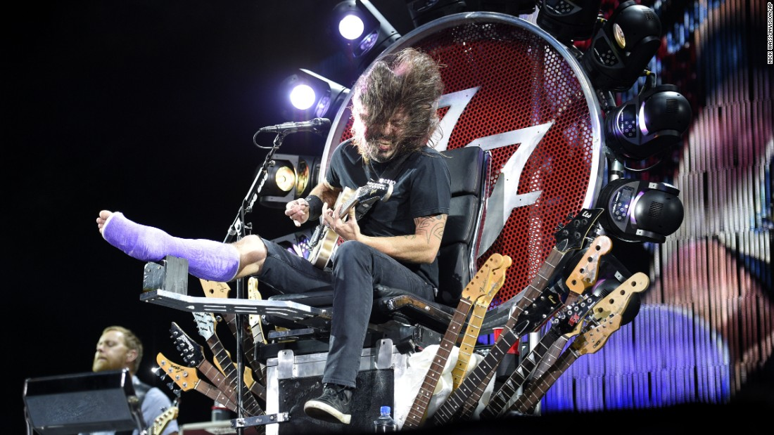 Foo Fighters frontman Dave Grohl sprang from the D.C. punk scene to become a member of Nirvana, a producer extraordinaire and a generally well-respected guy in the music business. Here, Grohl performs at RFK Stadium in Washington on July 4, 2015. The cast is for a broken leg caused by falling off a stage. Click through to see more from Grohl's career.