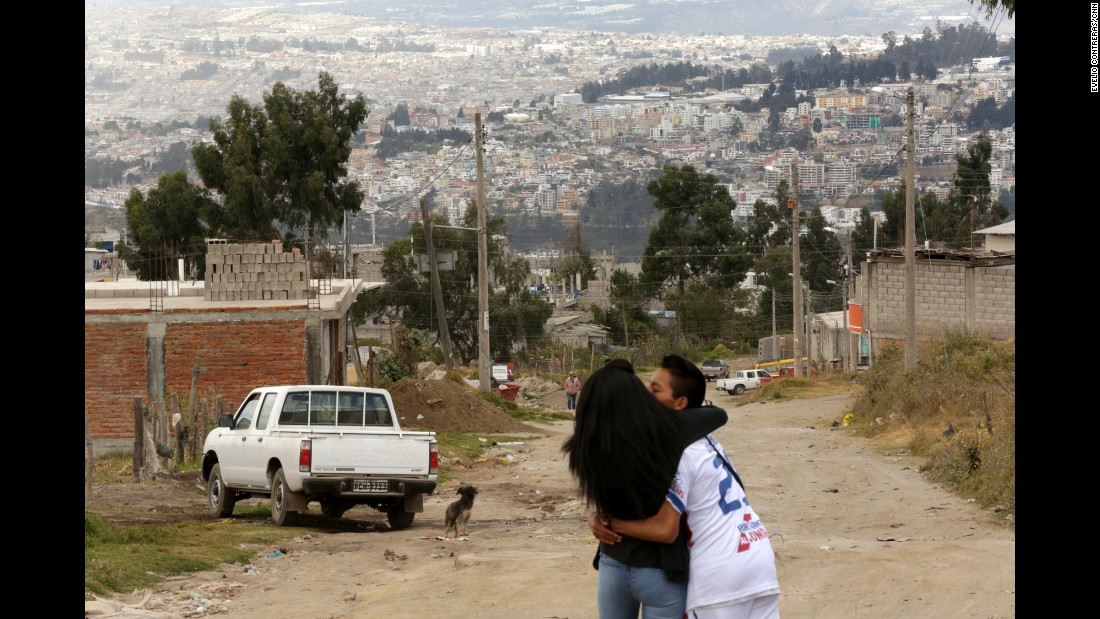 A couple embrace on the foothills of Pisuli, a neighborhood in North Quito, where Pope Francis will visit this week as part of his South American trip.