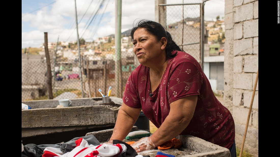 Mary Torres, 58, washes laundry for her five children on Saturday, July 4. She is hoping the Pope's visit will help bring attention to the poor in Quito.