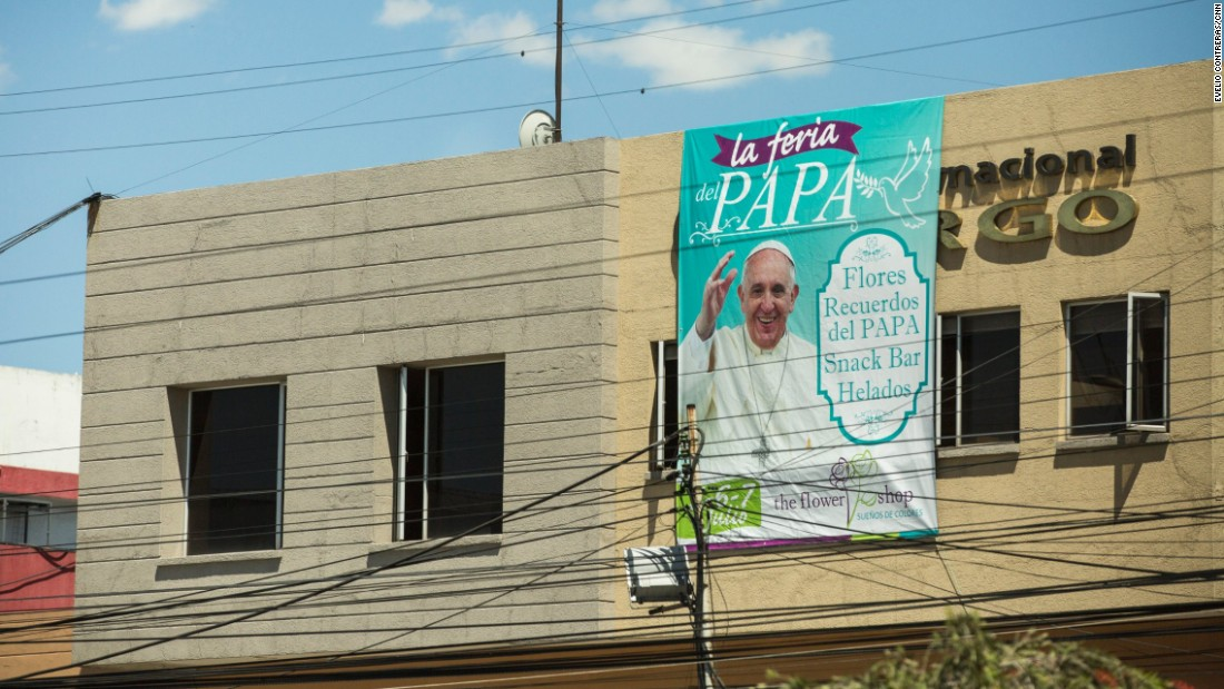 Signs welcoming Pope Francis are on many street corners in Quito, where he begins his visit to Ecuador on Sunday, July 5. This sign uses the Pope's images to draw attention to a flower shop in downtown Quito.