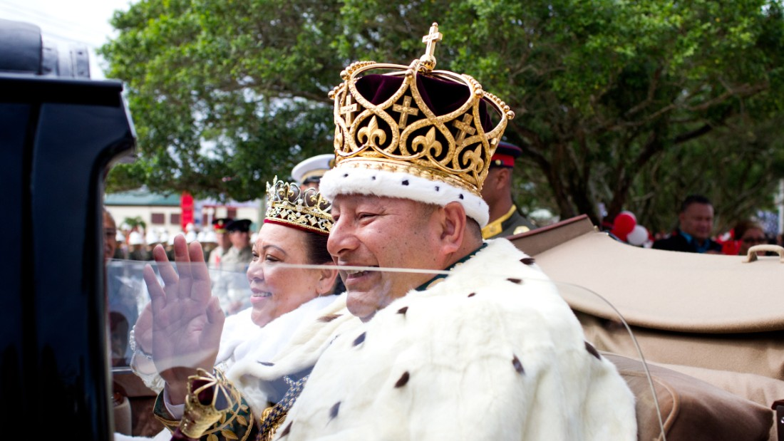 King Tupou VI and Queen Nanasipau'u proceed through the streets to the Royal Palace during the official coronation ceremony on July 4, 2015.