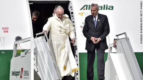 Pope Francis leaves the plane upon arrival at the Mariscal Sucre international airport in Quito on July 5.