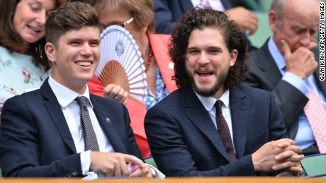 Kit Harington, right, sits in the Royal Box on Centre Court at the 2015 Wimbledon Championships.
