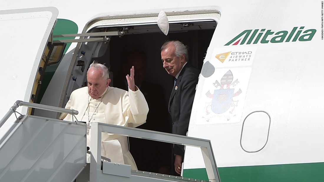 A gust of wind blows off Pope Francis' skullcap upon his arrival at the Mariscal Sucre International Airport in Quito on July 5.