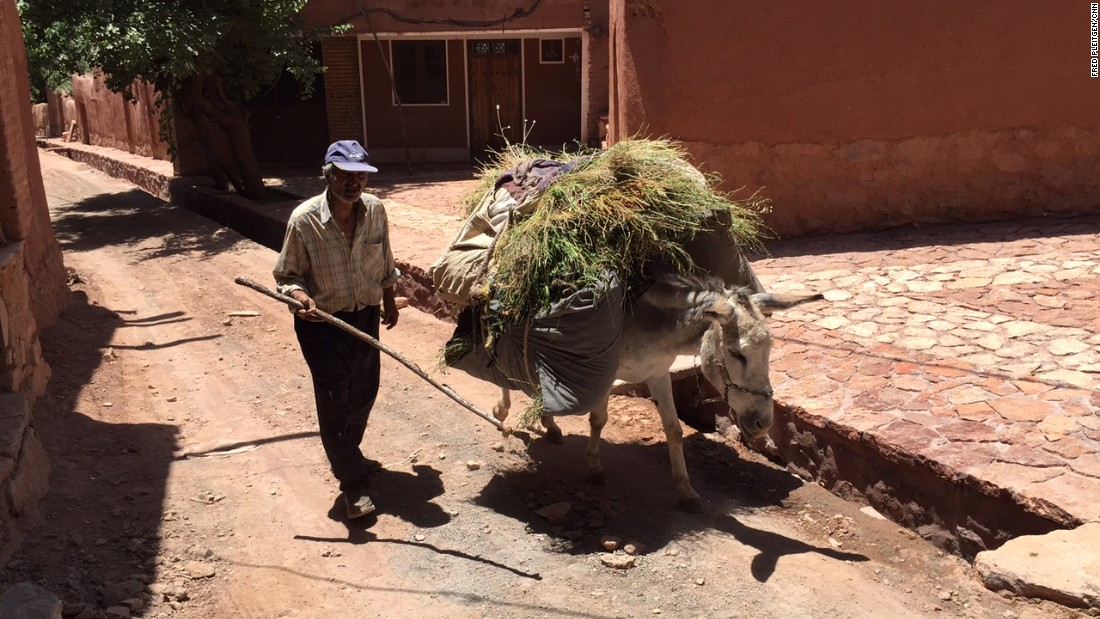 A man strolls down the street with his donkey. Abyaneh is unique even in a culturally diverse country such as Iran.