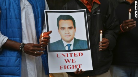 "Indian journalists hold candles and a photograph of Akshay Singh during a memorial meeting in Bangalore, India, Monday, July 6, 2015. Singh, an Indian television journalist died under mysterious circumstances Saturday while on assignment covering allegations of a massive scheme to manipulate the results of entrance examinations for government jobs and medical colleges in the central Indian state of Madhya Pradesh. The alleged scam labeled ""Vyapam"" by Indian media after the Hindi name of the state's professional examination board since the story first surfaced in 2013. (AP Photo/Aijaz Rahi)"