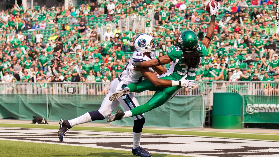Weldon Brown, a defensive back with the Saskatchewan Roughriders, breaks up a pass intended for Toronto's Tori Gurley, left, during a Canadian Football League game in Regina, Saskatchewan, on Sunday, July 5.