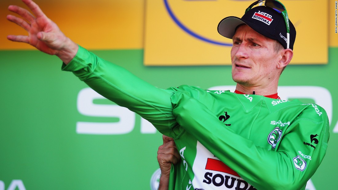 ... while Germany's Andre Greipel (Lotto-Soudal) took possession of the green (sprinter's) jersey.