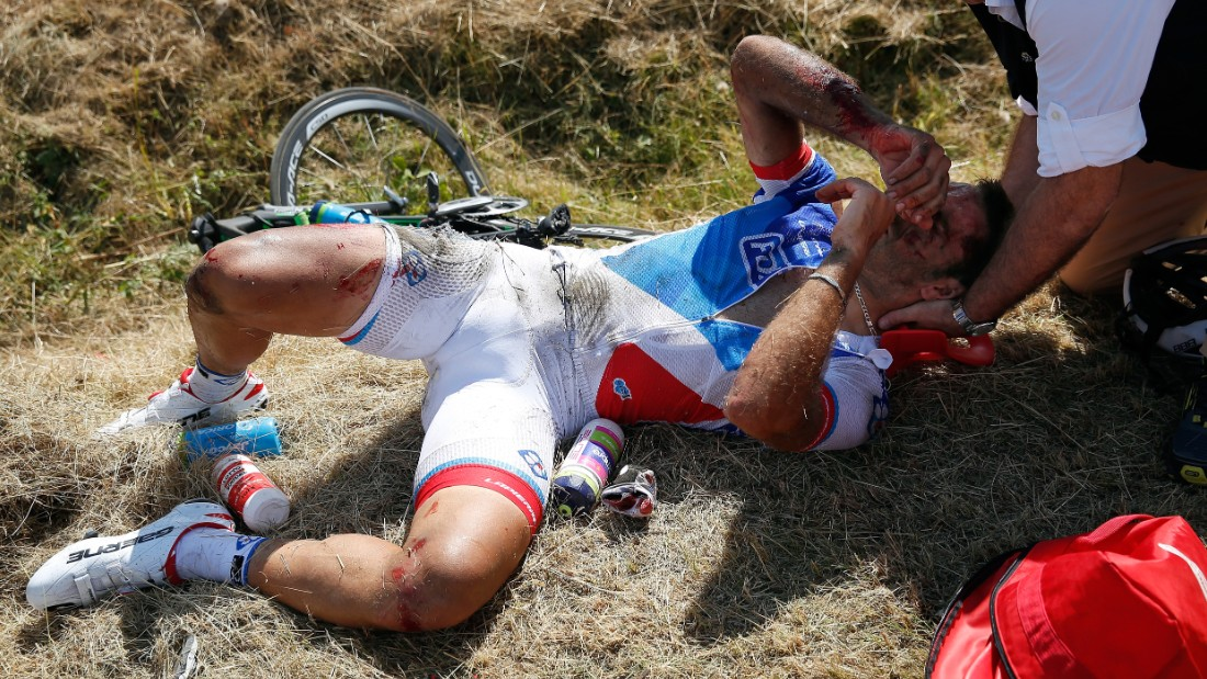 French rider William Bonnet lies battered, bloodied and bruised at the roadside following the crash. A subsequent trip to hospital revealed that he also had a fractured vertebrae.