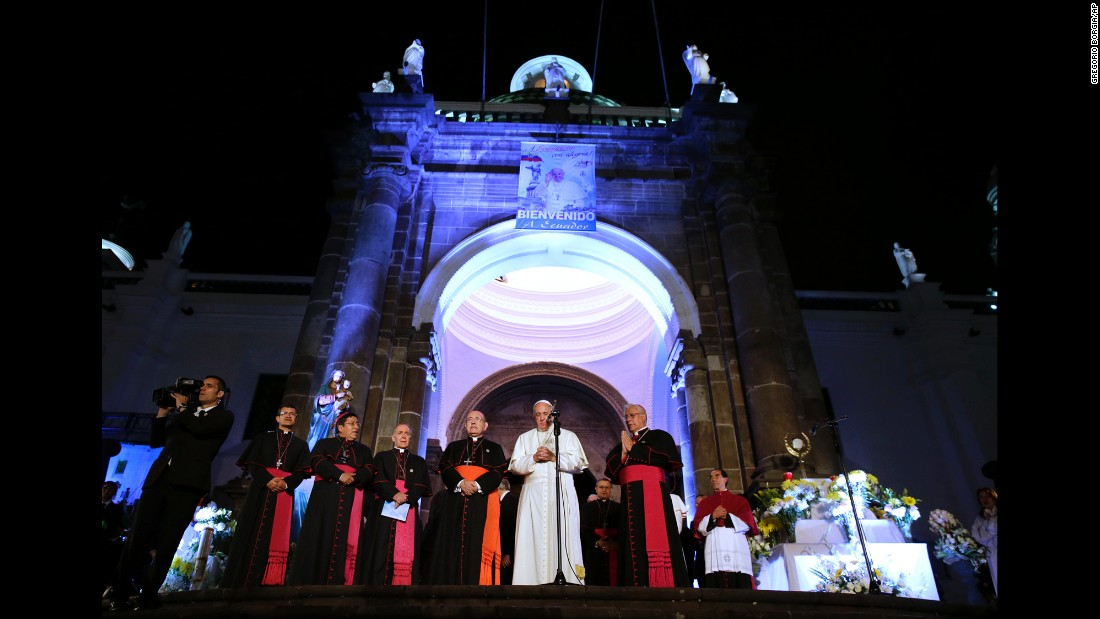 Pope Francis, center, prays outside the Cathedral of Quito on Monday, July 6.