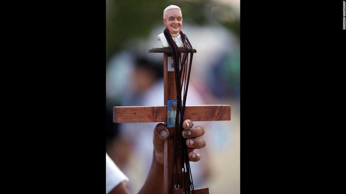 A street vendor sells a Pope Francis crucifix at Samanes Park on July 5.