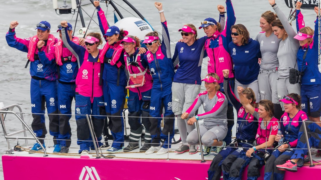 The Team SCA sailors celebrate their arrival into Lorient.