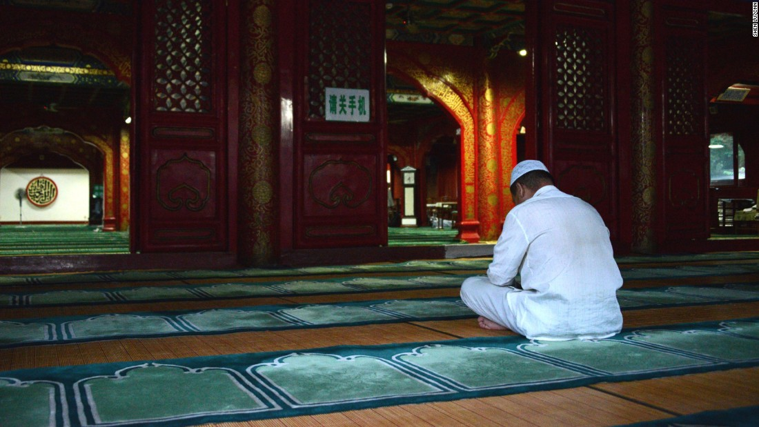 A man prays in Niujie Mosque, the oldest and largest mosque in Beijing, July 6. It was built in the year of 996.