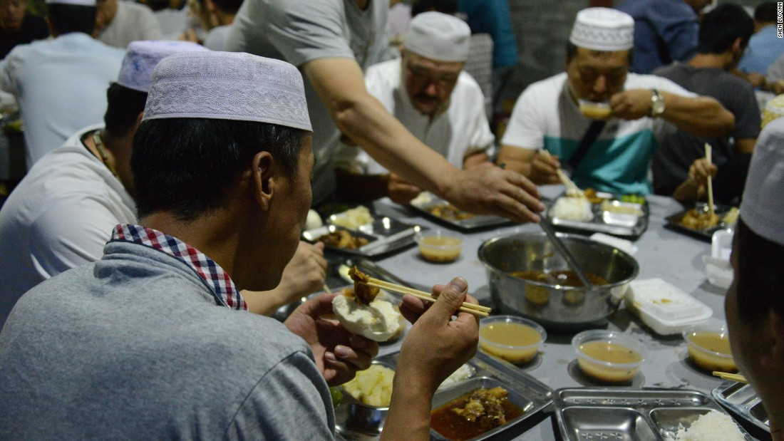 Men enjoy their Iftar meal at the mosque.