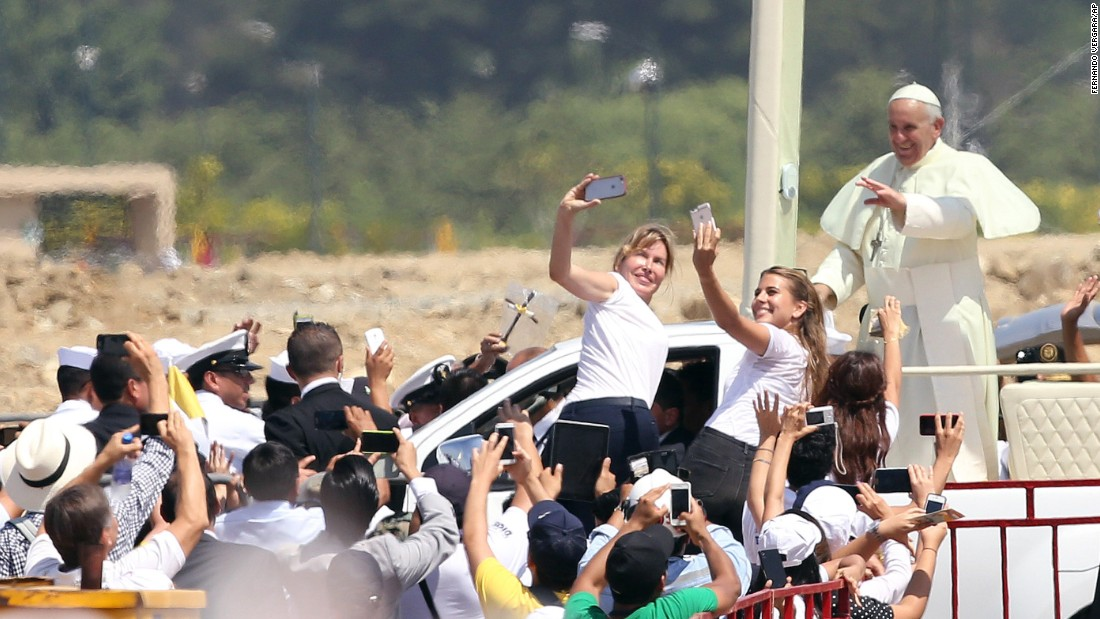 "Pope Francis waves to the crowd Monday, July 6, as he rides through Samanes Park in Guayaquil, Ecuador. The Pope is emphasizing the plight of the poor during <a href=""http://www.cnn.com/2015/07/05/americas/gallery/pope-francis-south-america/index.html"" target=""_blank"">his eight-day tour of South America.</a>"