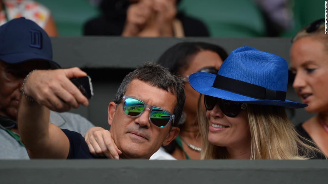 Actor Antonio Banderas gets a selfie with his girlfriend, Nicole Kempel, while watching countryman Rafael Nadal play tennis Thursday, July 2, at Wimbledon.