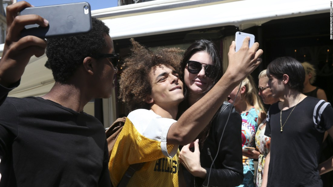 Television personality Kendall Jenner stops for a selfie as she leaves a restaurant in Paris on Monday, July 6.