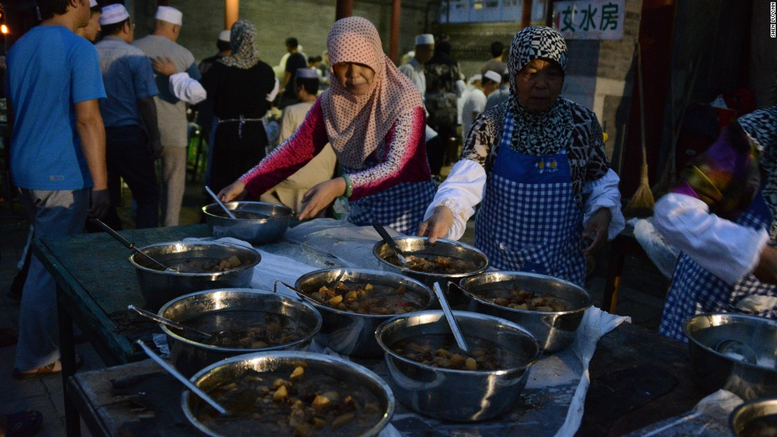 Women serve Iftar at the mosque, an evening meal Muslims eat together after ending their daily Ramadan fast.