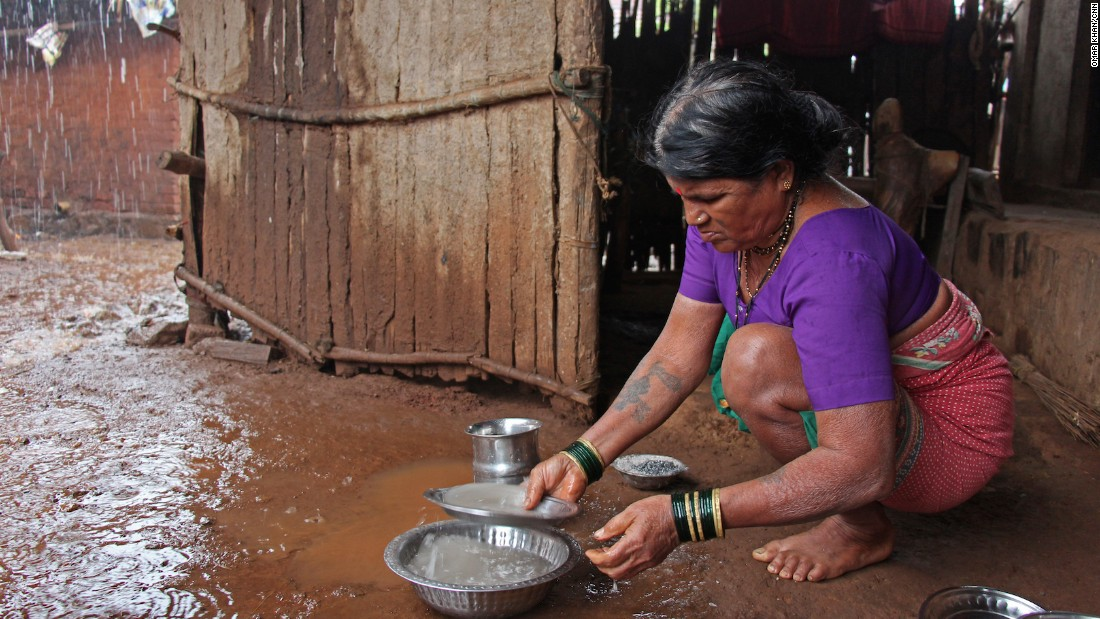 Tuki, the first wife, washes the utensils with rainwater. Tuki looks after the house while the other two wives are responsible for getting water.