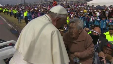 Woman in wheelchair carried to meet Pope