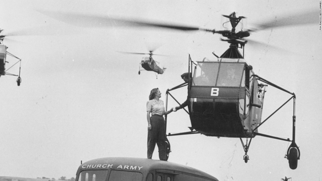 A Church Army canteen worker is seen here handing a cup of tea to the pilot of a Sikorsky R-4 helicopter hovering overhead at an RAF Helicopter School in Andover, England, in 1945. Though not an airplane, the R-4 was the world's first mass-produced helicopter.