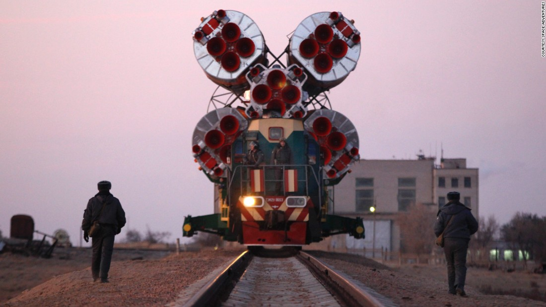 The Soyuz rocket is transported by rail to the launch pad.