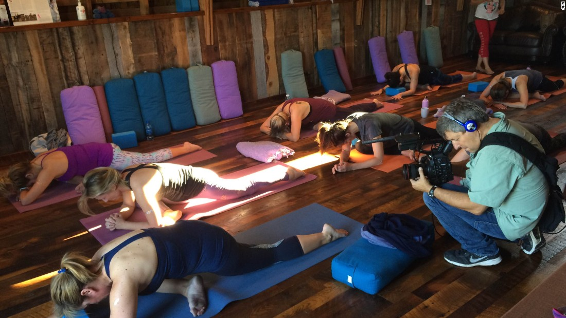 "Getting over the fear of riding or interacting with a horse is a big focus for many of Cowgirl Yoga's clients. ""To be able to come here and mix that with the yoga is just wonderful. It's the horse-human connection, and being open to whatever that brings,"" Vap says."