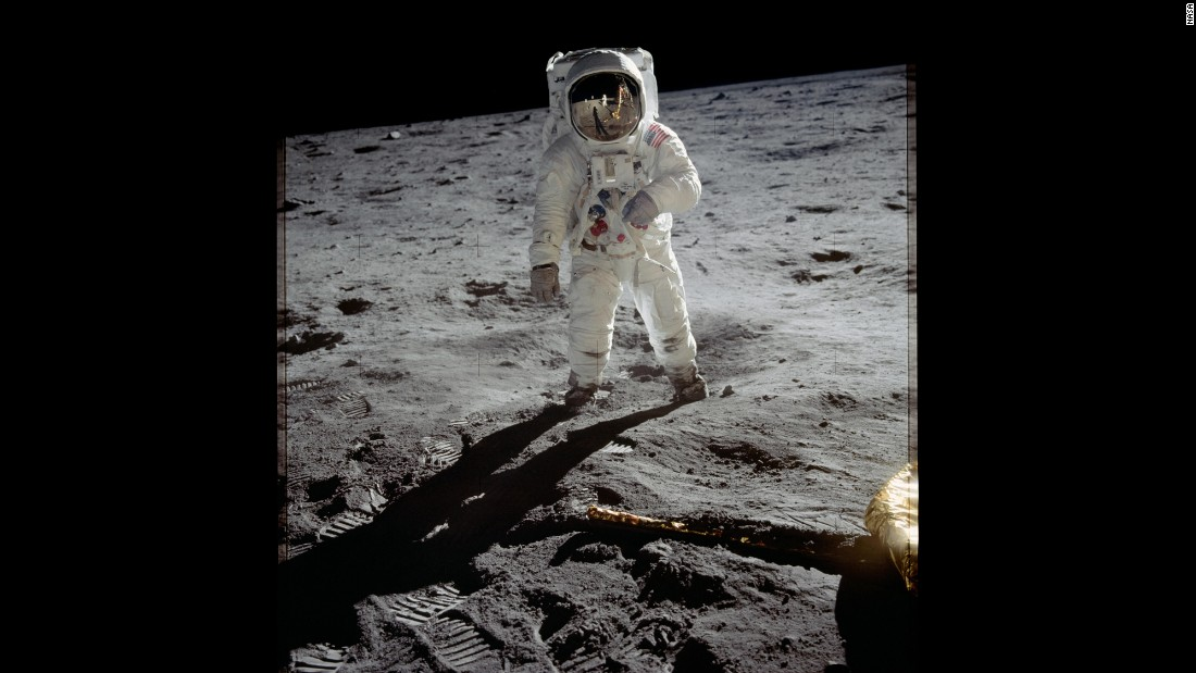 "Aldrin is photographed on the moon after Armstrong went first and called it ""one small step for man, one giant leap for mankind."" Armstrong and Aldrin explored the Sea of Tranquility region of the moon. Meanwhile, Collins remained inside the command module for the duration of the mission."