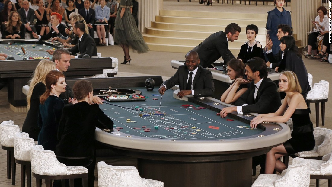 Karl Largerfeld shows have taken us to supermarkets, brasseries, and the woods but this season we found ourselves in a celebrity-packed casino. <br />This photo shows Kirsten Stewart, Julianne Moore, Lily-Rose Depp, and Lara Stone gambling in head-to-toe couture.