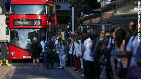 Commuters form queues to board buses at Victoria station during the Tube strike on Thursday.