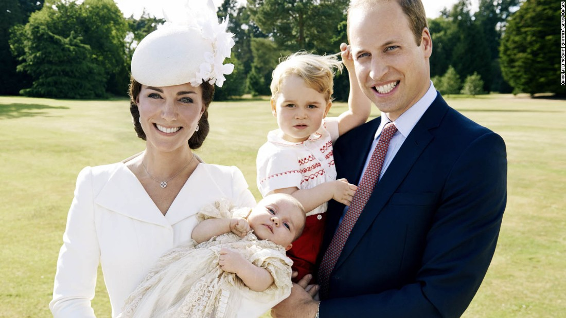 The family poses for a photo at Charlotte's christening in July 2015.
