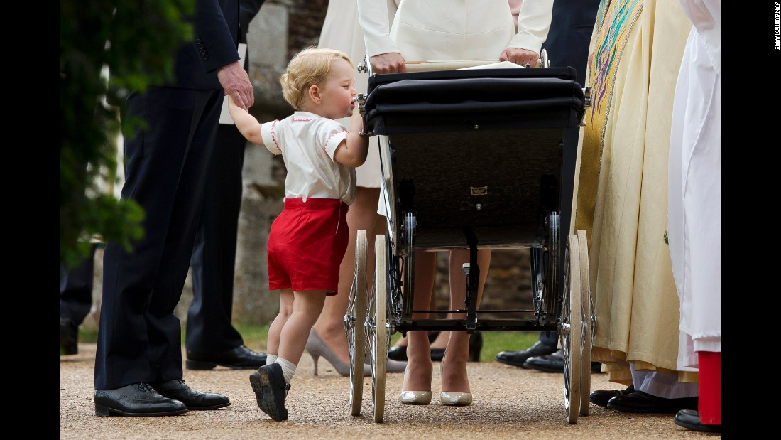 "Britain's Prince George peeks into the carriage holding his sister, Princess Charlotte, <a href=""http://www.cnn.com/2015/05/02/world/gallery/royal-baby-princess-announced/index.html"" target=""_blank"">after her christening</a> Sunday, July 5, in Norfolk, England."