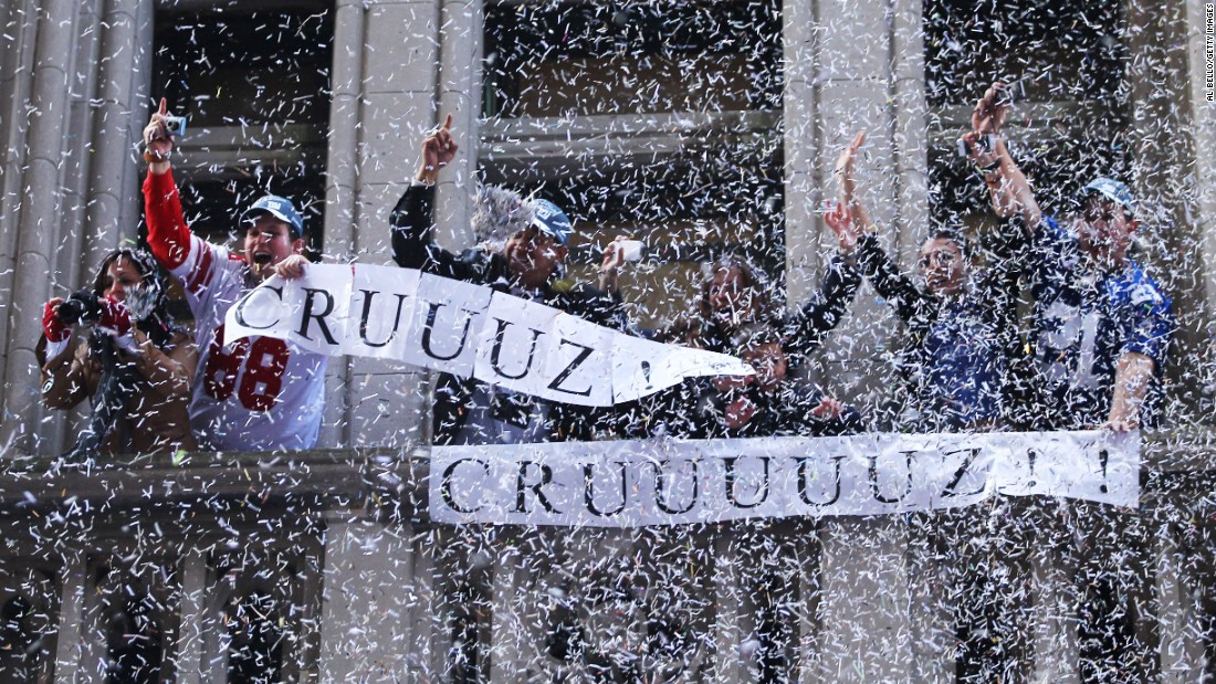 In recent years, most of New York's ticker tape parades have been in celebration of a sports team. Here, fans hold banners supporting New York Giants player Victor Cruz. The team won the Super Bowl in 2012.