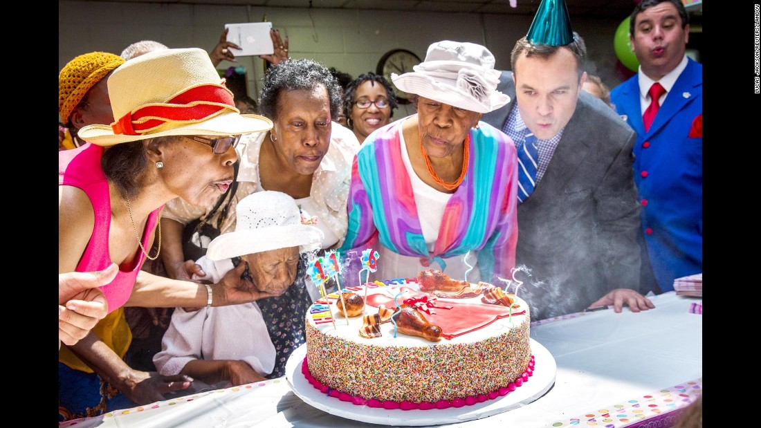 "Susannah Mushatt Jones, seated, celebrates her 116th birthday with family and friends Tuesday, July 7, in New York. ""Miss Susie"" is the world's oldest living person. She <a href=""http://www.cnn.com/2015/07/06/living/worlds-oldest-woman-feat/"" target=""_blank"">attributes her longevity</a> to sleep, clean living and positive energy."