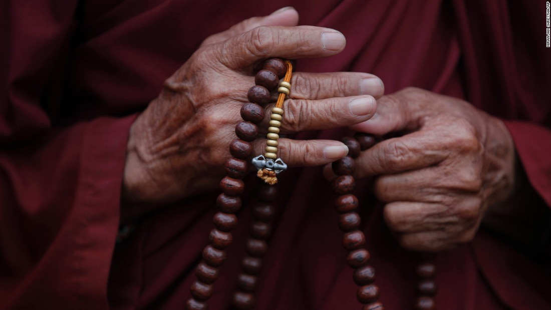 A Tibetan monk in Kathmandu, Nepal, offers prayers to mark the 80th birthday of the Dalai Lama on Monday, July 6.