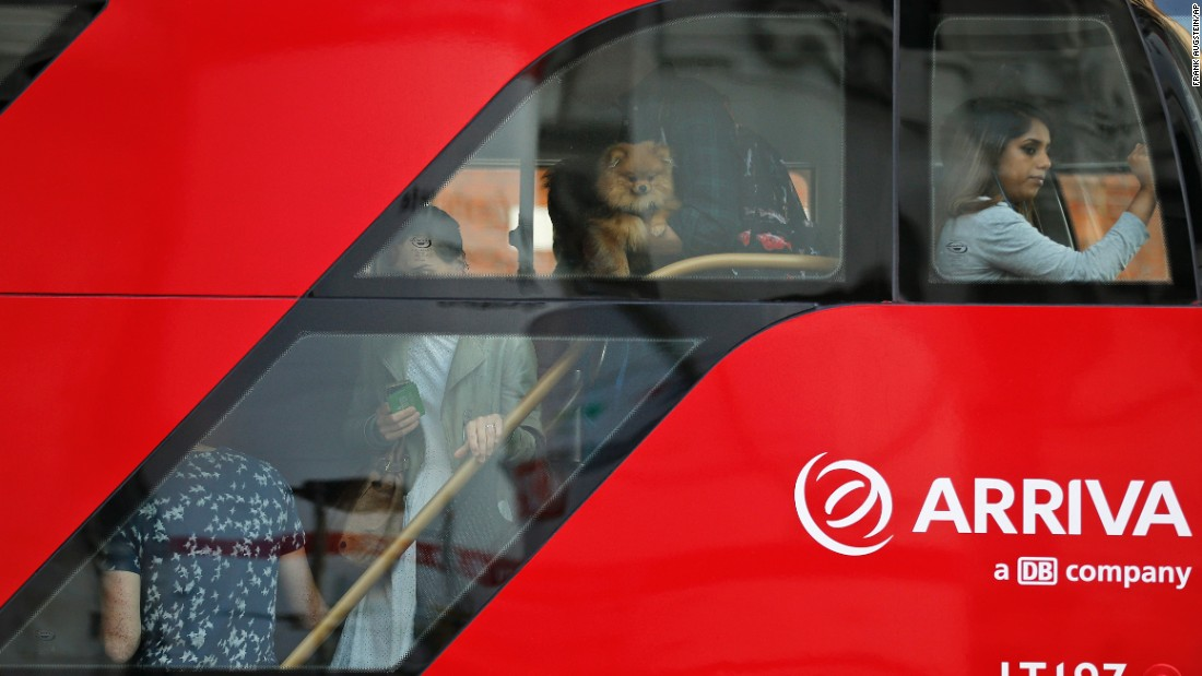 "Commuters are seen through the windows of a packed bus in London on Thursday, July 9. Millions of Londoners were forced to find alternative ways to travel as the capital's Underground network <a href=""http://www.cnn.com/2015/07/09/travel/uk-london-underground-tube-strike/index.html"" target=""_blank"">was in the grip of a 24-hour strike.</a>"