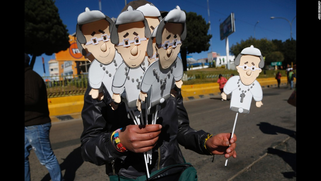 "A street vendor sells cutout images of Pope Francis near the airport in El Alto, Bolivia, on Wednesday, July 8. <a href=""http://www.cnn.com/2015/07/07/living/gallery/pope-francis-memorabilia-south-america/index.html"" target=""_blank"">Memorabilia is being sold across South America</a> to commemorate the Pope's <a href=""http://www.cnn.com/2015/07/05/americas/gallery/pope-francis-south-america/index.html"" target=""_blank"">eight-day tour</a> of Ecuador, Bolivia and Paraguay."
