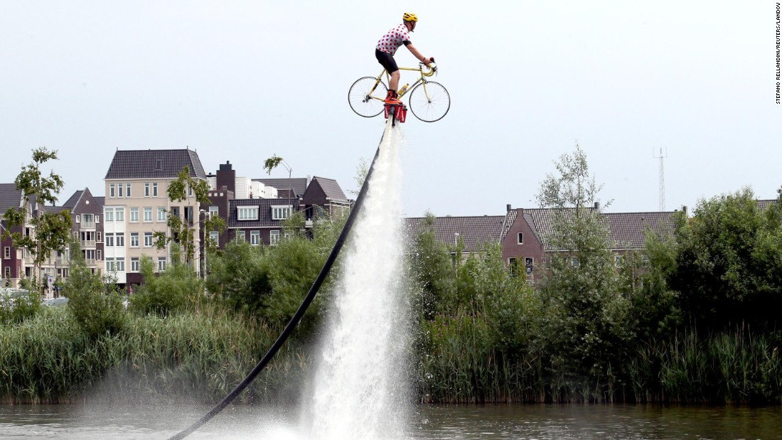 "A man in Utrecht, Netherlands, flyboards on a bicycle on Sunday, July 5. The Tour de France bicycle race started in Utrecht this year. <a href=""http://www.cnn.com/2015/07/09/living/gallery/tbt-tour-de-france-robert-capa/index.html"" target=""_blank"">#tbt: See Robert Capa's photos from the 1939 Tour de France</a>"