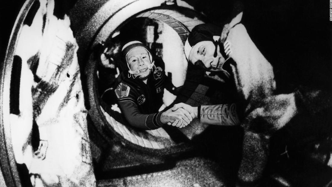 Commander of the Soviet crew of Soyuz Alexey Leonov, left, and commander of the American crew of Apollo Thomas Stafford shake hands in space after the Apollo and Soyuz spacecrafts docked on July 17, 1975.